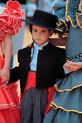 Europe, Spain, Andalucia, Sevilla (also known as Seville), boy in traditional clothing at Feria del Sevilla festival, held annually in April