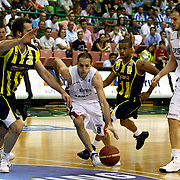 Efes Pilsen's Igor RAKOCEVIC (C), Ermal KURTOGLU (R) and Fenerbahce Ulker's Lynn Terence GREER (2ndR), Oguz SAVAS (L) during their Turkish Basketball league Play Off Final fifth leg match Efes Pilsen between Fenerbahce Ulker at the Ayhan Sahenk Arena in Istanbul Turkey on Sunday 30 May 2010. Photo by Aykut AKICI/TURKPIX
