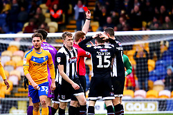 Luke Waterfall of Grimsby Town is shown the red card - Mandatory by-line: Ryan Crockett/JMP - 04/01/2020 - FOOTBALL - One Call Stadium - Mansfield, England - Mansfield Town v Grimsby Town - Sky Bet League Two