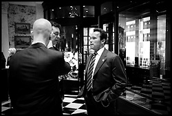 Arnold Schwarzenegger stands in the fayor of the Savoy after having lunch while on a 3 day trip to London. Photo By Andrew Parsons/ i-Images