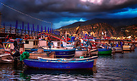 """""""Sorrento panorama of tired fishing boats - Marina Grande Sorrento""""...<br /> <br /> Duomo di Sorrento is one of my favorite hidden treasures of Italy. Our last day on the bellissimo Amalfi Coast, Father Peak offered a venerable morning Mass for our semi-exhausted group of Pilgrims upon the High Altar. Hallelujah, it was our first free day of the 2019 Pilgrimage and most were heading to Capri. I convinced my fellow Pilgrim Patrick that Marina Grande was the preferred location to commemorate this rain-threatened day. Sunday afternoon in this tiny hallowed port on the Mediterranean was bustling, not with tourists, but with energetic and unassuming locals. The misty skies were vulnerable all day with the promise of rain, but the reluctant sun penetrated the clouds for a few fortuitous moments. God painted the skies for brief moments with luminous pastel elements of abstract color. We left after lunch only to humbly return perceiving the brilliant orange skies cascading down upon the piccolo village as a gift from Heaven. Glorious rumination abounds with the thought of sacred scripture; """"John answered them all, saying, 'I am baptizing you with water, but one mightier than I is coming. I am not worthy to loosen the thongs of his sandals. He will baptize you with the Holy Spirit and fire. His winnowing fan is in his hand to clear his threshing floor and to gather the wheat into his barn, but the chaff he will burn with unquenchable fire."""" (Luke 3:16-17) I am not an expert in, nor born in Marina Grande or Sorrento, but the Gulf of Naples is where my Grandfather and his family are from. It seems that every time I have set foot in this tiny village, the skies explode with color and welcome its former lineage home. Shortly after the last picture was captured, it was meal time with the entire Pilgrimage group. A perfect dinner at my favorite restaurant, Ristorante di """"Zi'Ntonio Mare, was enjoyed by all!"""