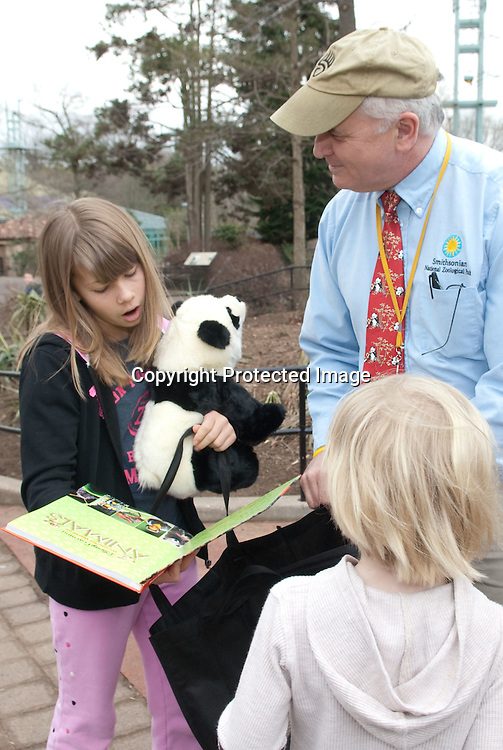 """(*Handout*) MAR-11-2010: Bindi(L), and Robert Irwin(R) receive a gift bag from National Zoo animal care director Don Moore during a promotional event for Bindi's upcoming """"Free Willy 4: Escape from Pirate's Cove"""" movie at the National Zoo in Washington DC on March 11, 2010. Photo by Kris Connor for Warner Bros."""