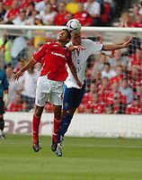 Photo: Leigh Quinnell.<br /> Nottingham Forest v Brighton & Hove Albion. Coca Cola League 1. 19/08/2006. Forsets Jack Lester rises with Brightons Joel Lynch.