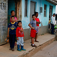 Central America, Cuba, Remedios. Cuban family and kids on street in Remedios.