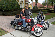 Orange County Sheriff Jerry Demings, right, poses with his wife Val Demings, former Chief of the Orlando Police Department, with their motorcycles in front of their home in Orlando, Fla., Sunday, Jan. 10, 2016. (Photo by Phelan M. Ebenhack)