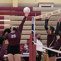 Ramah's McKenzie Jimenez (20) tips the ball over the net in their varsity volleyball match against Rehoboth Christian Tuesday in Rehoboth. Rehoboth won the match 3-0.
