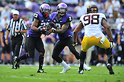 FORT WORTH, TX - SEPTEMBER 13:  Trevone Boykin #2 of the TCU Horned Frogs hands the ball off to B.J. Catalon #23 against the Minnesota Golden Gophers on September 13, 2014 at Amon G. Carter Stadium in Fort Worth, Texas.  (Photo by Cooper Neill/Getty Images) *** Local Caption *** Trevone Boykin; B.J. Catalon