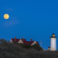New England photography of the pink full moon over Nobska Lighthouse. This iconic Massachusetts Cape Cod lighthouse is located near Woods Hole Village in Falmouth, MA on the Cape.<br /> <br /> Beautiful Massachusetts lighthouse photography images are available as museum quality photography prints, canvas prints, acrylic prints, wood prints or metal prints. Fine art prints may be framed and matted to the individual liking and interior design decorating needs:<br /> <br /> https://juergen-roth.pixels.com/featured/pink-full-moon-over-nobska-lighthouse-juergen-roth.html<br /> <br /> Good light and happy photo making!<br /> <br /> My best,<br /> <br /> Juergen