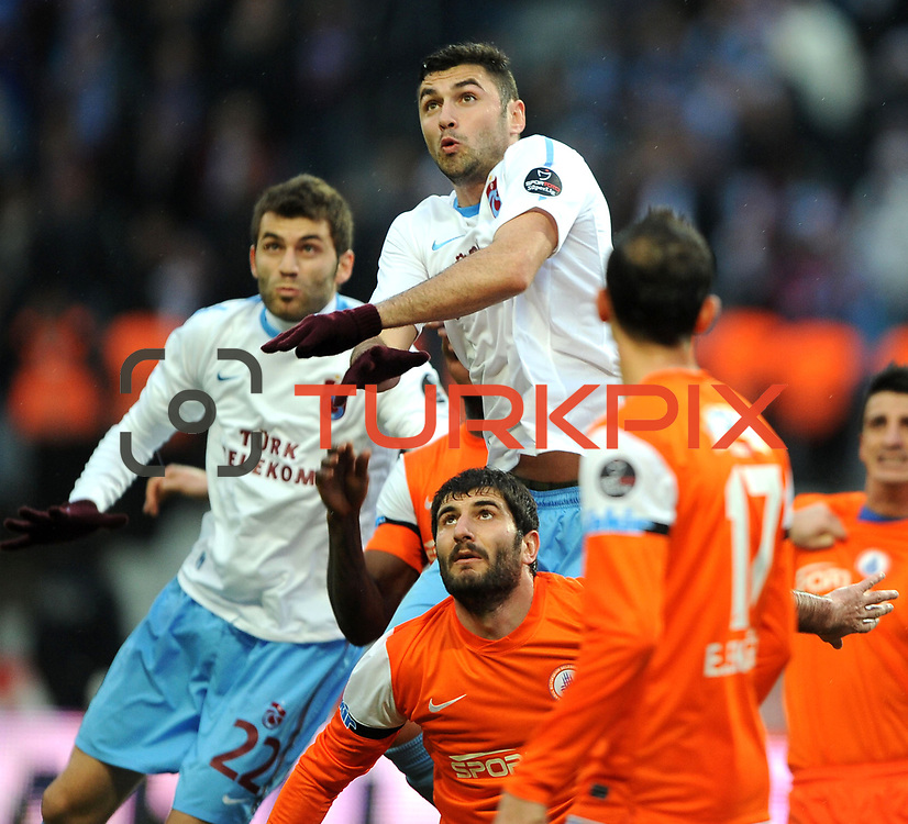 Trabzonspor's Burak Yilmaz (C) during their Turkish soccer superleague match IBBSpor between Trabzonspor at the Ataturk Olympic stadium in Istanbul Turkey on Saturday 07 January 2012. Photo by TURKPIX