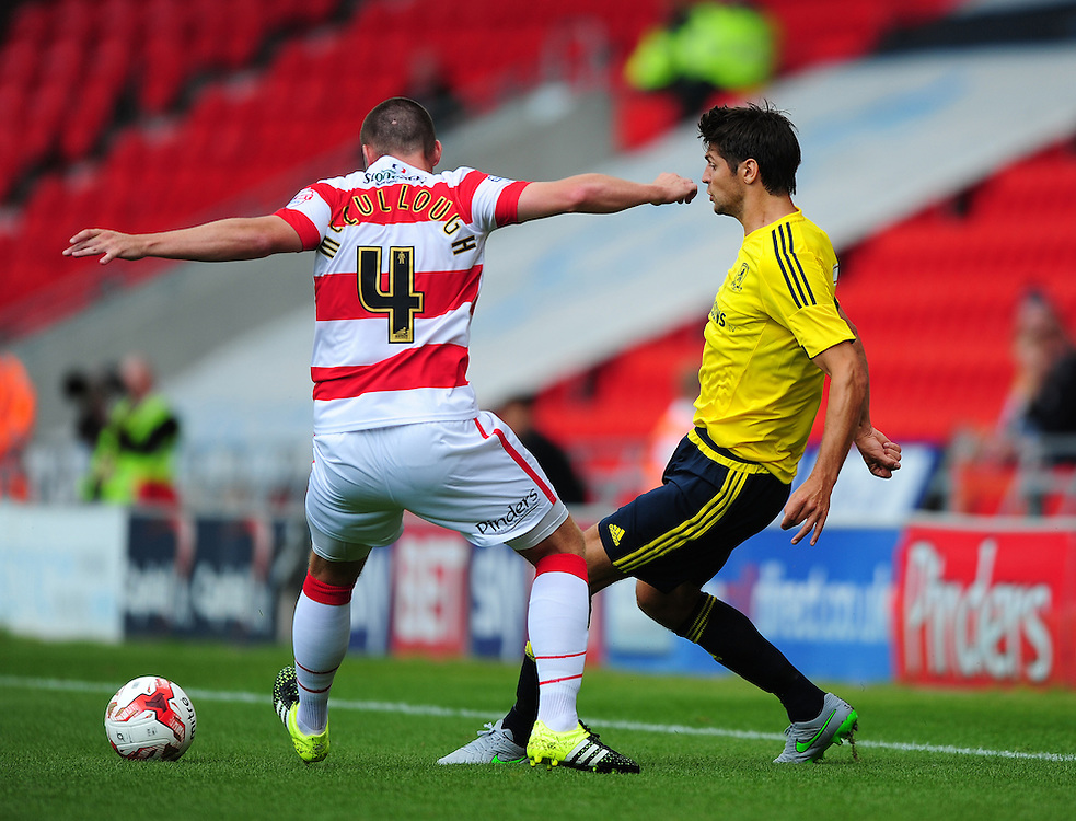 Middlesbrough's George Friend vies for possession with Doncaster Rovers' Luke McCullough<br /> <br /> Photographer Chris Vaughan/CameraSport<br /> <br /> Football - Pre-Season Friendly - Doncaster Rovers v Middlesbrough - Saturday 25th July 2015 - Keepmoat Stadium, Doncaster<br /> <br /> © CameraSport - 43 Linden Ave. Countesthorpe. Leicester. England. LE8 5PG - Tel: +44 (0) 116 277 4147 - admin@camerasport.com - www.camerasport.com