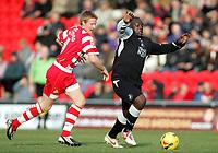 Photo: Paul Thomas.<br /> Doncaster Rovers v Swansea City. Coca Cola League 1. 17/02/2007.<br /> <br /> Adebayo Akinfenwa (R) of Swansea gets past Adam Lockwood.