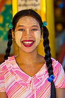 Burmese woman wearing thanaka bark, makeup, Bago, Myanmar (Burma)