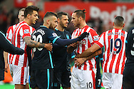 Marko Arnautovic of Stoke City (10) is not happy with something at the final whistle while other players try to calm him down. Barclays Premier league match, Stoke city v Manchester city at the Britannia Stadium in Stoke on Trent, Staffs on Saturday 5th December 2015.<br /> pic by Chris Stading, Andrew Orchard sports photography.