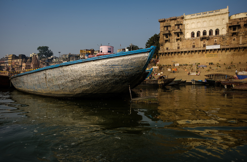 VARANASI, INDIA - CIRCA NOVEMBER 2016: Manmandir Ghat in the Ganges river early morning. The city of Varanasi is the spiritual capital of India, it is the holiest of the seven sacred cities in Hinduism and Jainism. The Ganges is also considered a sacred river.