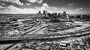 SHOT 2/25/21 9:49:56 AM - Aerial view of Interstate 25 as it passes by downtown Denver, Co. after a winter snowstorm left a coat of fresh snow over the city. Interstate 25 is a major Interstate Highway in the western United States. It is primarily a north–south highway, serving as the main route through New Mexico, Colorado, and Wyoming. I-25 stretches from Interstate 10 at Las Cruces, New Mexico, to Interstate 90 in Buffalo, Wyoming. Denver is the capital of Colorado and is an American metropolis of some 700,000 people. Denver is the 19th-most populous city in the United States, the fifth-most populous state capital, and the most populous city located in the Mountain states. It is nicknamed the Mile High City because its official elevation is exactly one mile (5280 feet or 1609.344 meters) above sea level. (Photo by Marc Piscotty / © 2021)