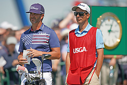 June 16, 2018 - Southampton, NY, USA - Scott Piercy and caddy Travis Perkins at the 1st tee during the third round of the 2018 U.S. Open at Shinnecock Hills Country Club in Southampton, N.Y., on Saturday, June 16, 2018. (Credit Image: © Brian Ciancio/TNS via ZUMA Wire)