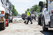 City workers remove water and mud from La Crosse Drive on Aug. 2, 2012, after an 8-inch potable water main beneath the street failed Wednesday evening, causing thousands of gallons of water to gush into surrounding streets and nearby homes.  Damages are unknown.  Photo by Stan Olszewski/SOSKIphoto.