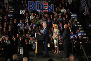 Democratic presidential candidate former Vice President Joe Biden and Jill Biden, are applauded by supporters as he takes the stage with Rep. Jim Clyburn during his victory party after winning the South Carolina primary February 29 2020, in Columbia, South Carolina.