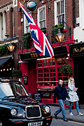 Large scale Union Jack flag outside the Globe pub in Covent Garden, central London.