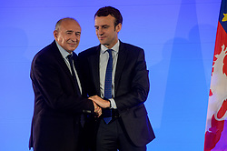 Minister of the Economy, Industry and the Digital Sector Emmanuel Macron shakes hands with Gerard Collomb, mayor of Lyon in front of economic and creative forces of the Territory at the City Hall of Lyon, France on June 2nd 2016. Photo by Julien Reynaud/APS-Medias/ABACAPRESS.COM
