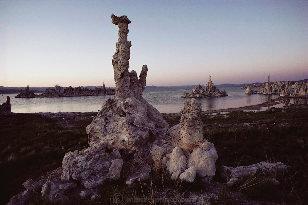 Tufa towers in Mono Lake. Mono Lake lie near the town of Lee Vining. It is at least 700,000 years old and one of the oldest continuously existing lakes on the continent. Tufa towers (photographed) are made from calcium and carbonate combine to form limestone, which builds up over time around the lake bottom spring openings. Declining lake levels have exposed the tufa towers we see today. Some of the tufa towers are up to 30 feet high. Route 395: Eastern Sierra Nevada Mountains of California.
