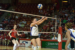 12 November 2006: Kristin Belzung sets the ball, Lindley McDavid watches from the other side of the net. In the final regular season home game at ISU, the Northern Iowa Panthers defeated the Illinois State Redbirds 3 game to 1. The match took place at Redbird Arena on the campus of Illinois State University in Normal Illinois.<br />