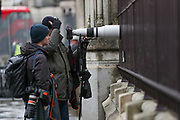 February 13, 2020, London, England, United Kingdom: Two photographers guarding entry of the House of Commons with their cameras after British Prime Minister Boris Johnson shook up his government on Thursday, firing and appointing ministers to key Cabinet posts. Johnson was aiming to tighten his grip on the government after winning a big parliamentary majority in December's election. That victory allowed Johnson to take Britain out of the European Union in January. (Credit Image: © Vedat Xhymshiti/ZUMA Wire)