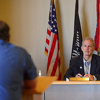 Chairman Anthony Tanner hears from a presenter at the  County Commission meeting in Gallup Tuesday.