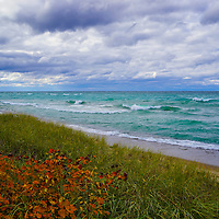 """""""Lake Superior Colors""""<br /> <br /> Enjoy the amazing colors of the beautiful blues and greens of the waters of Lake Superior. Feel the movement of the clouds above, and relish in the contrast of fall color against the greens of the sand grass on a windy autumn day!"""