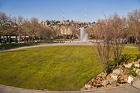 The central green of the Seattle Center is typically where people come to lounge together in multiple groups. Its empty state draws one's immediate attention to the spouts of the International Fountain in the background. (March 22, 2020).