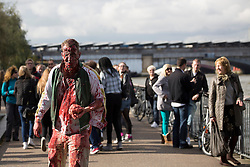 © licensed to London News Pictures. London, UK 13/10/2012. A man with zombie make-up walking in Southbank, London as more than 2,000 'zombies' celebrating World Zombie Day on 13/10/12 in London. Photo credit: Tolga Akmen/LNP