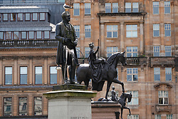 Glasgow, Scotland, UK. 12 June 2020. Police patrol George Square in the city centre to prevent vandalism to the many historic statues located here. Following the recent Black Lives Matter demonstrations in the UK,  many colonial era statues have been targeted by protestors. Pic; Robert Peel nearest is thought to be prime target.  Iain Masterton/Alamy Live News