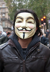 © under license to London News Pictures. 30/11/2010. Students march in London for the third time to protest against the raising of tuition fees. Pictured is a student wearing a V for Vendetta mask.  Credit should read Matt Cetti-Roberts/London News Pictures