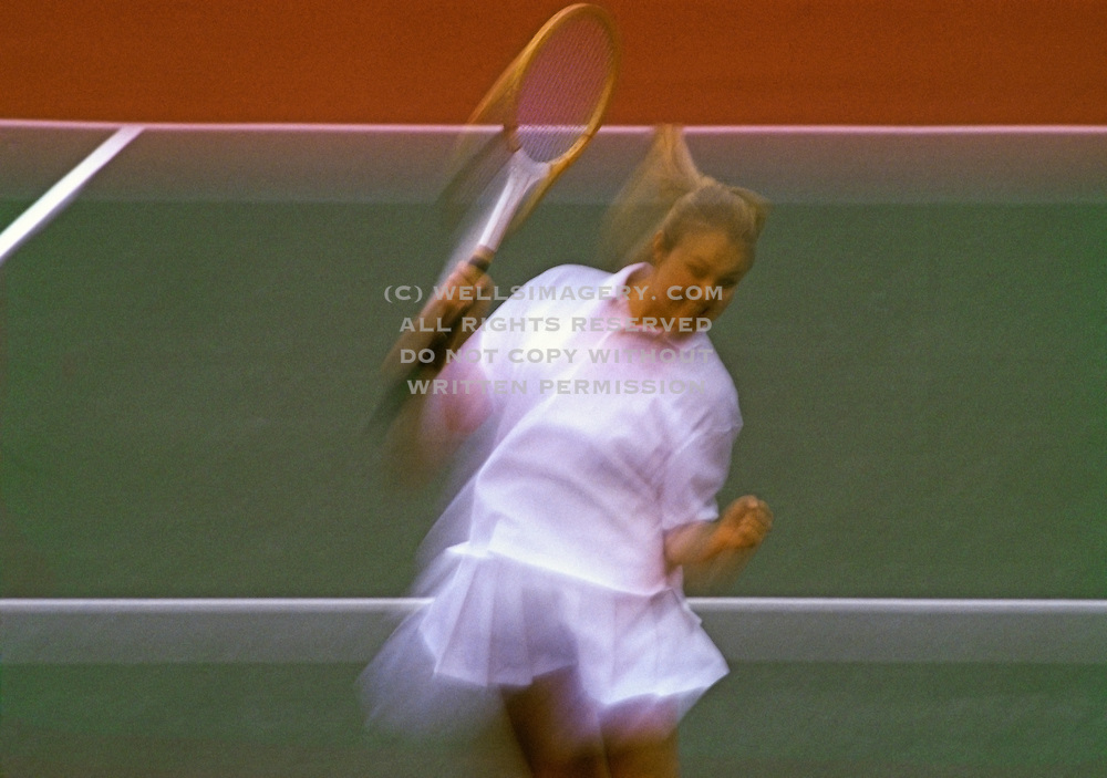 Image of a young woman playing tennis, model released by Andrea Wells