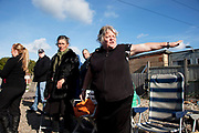 Travellers prepare for a press conference at Dale Farm site prior to eviction. Riot police and bailiffs were present on 20th October 2011, as the site was cleared of the last protesters chained to barricades. Dale Farm is part of a Romany Gypsy and Irish Traveller site in Crays Hill, Essex, UK<br /> <br /> Dale Farm housed over 1,000 people, the largest Traveller concentration in the UK. The whole of the site is owned by residents and is located within the Green Belt. It is in two parts: in one, residents constructed buildings with planning permission to do so; in the other, residents were refused planning permission due to the green belt policy, and built on the site anyway.