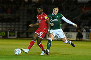 Bez Lubala (30) of Crawley Town battles for possession with Antoni Sarcevic (7) of Plymouth Argyle during the EFL Sky Bet League 2 match between Plymouth Argyle and Crawley Town at Home Park, Plymouth, England on 28 January 2020.