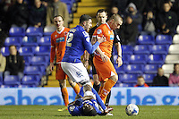 Blackpool's Jamie O'Hara is pushed away by Birmingham City's Lee Novak after fouling  Clayton Donaldson<br /> <br /> Photographer Mick Walker/CameraSport<br /> <br /> Football - The Football League Sky Bet Championship - Birmingham City v Blackpool - Wednesday 4th March 2015 - St Andrews - Birmingham<br /> <br /> © CameraSport - 43 Linden Ave. Countesthorpe. Leicester. England. LE8 5PG - Tel: +44 (0) 116 277 4147 - admin@camerasport.com - www.camerasport.com