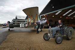 © Licensed to London News Pictures. 29/08/2012. Old Warden, UK Workmen remove the Royal Aircraft Factory RE.8, a reproduction, from the airfield and into a hanger to protect it from the heavy rain. The Royal Airforce Museum unveils three World War One aircraft at the Shuttleworth Aerodrome in Bedfordshire today, 29th August 2012.  The Snipe, Albatros DVa and RE8 will fly in airshows before going on public display at the Museum's London site Photo credit : Stephen Simpson/LNP