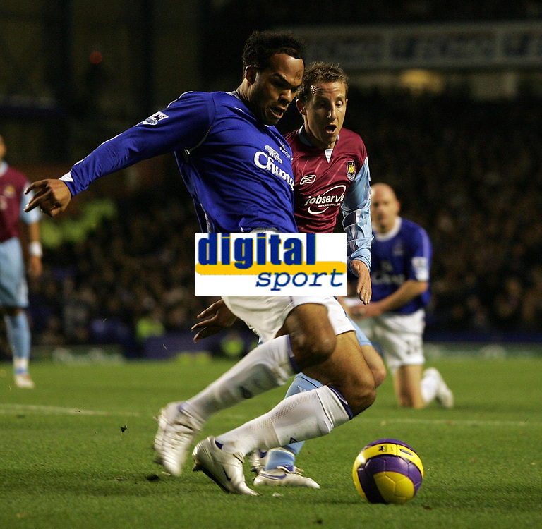 Photo: Paul Thomas.<br /> Everton v West Ham United. The Barclays Premiership. 03/12/2006.<br /> <br /> Joleon Lescott (L) of Everton, clears from Lee Bowyer of West Ham.