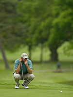 Photograph: Scott Heavey<br />Volvo PGA Championship At Wentworth Club. 23/05/2003.<br />Retief Goosen lines up a putt on the 11th.
