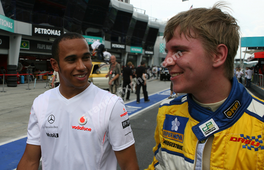 McLaren-Mercedes driver Lewis Hamilton and GP2 driver Christian Bakkerud in the pits at the Sepand circuit before the 2008 Malaysian Grand Prix. Photo: Grand Prix Photo