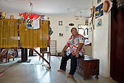 "Baron Divavesi Waqa, the opposition leader. .He says he is victim to ""Paba"", a Nauruan tradition that allows any relative to come into your house and take anything they like, whenever you have had something good that happened in your life (like a promotion in your job, a birth, birthday etc). Therefore, he says, the interior of his house is quite empty...Nauru, officially the Republic of Nauru is an island nation in Micronesia in the South Pacific.  Nauru was declared independent in 1968 and it is the world's smallest independent republic, covering just 21 square kilometers..Nauru is a phosphate rock island and its economy depends almost entirely on the phosphate deposits that originate from the droppings of sea birds. Following its exploitation it briefly boasted the highest per-capita income enjoyed by any sovereign state in the world during the late 1960s and early 1970s..In the 1990s, when the phosphate reserves were partly exhausted the government resorted to unusual measures. Nauru briefly became a tax haven and illegal money laundering centre. From 2001 to 2008, it accepted aid from the Australian government in exchange for housing a Nauru detention centre, with refugees from various countries including Afghanistan and Iraq..Most necessities are imported on the island..Nauru has parliamentary system of government. It had 17 changes of administration between 1989 and 2003. In December 2007, former weight lifting medallist Marcus Stephen became the President."