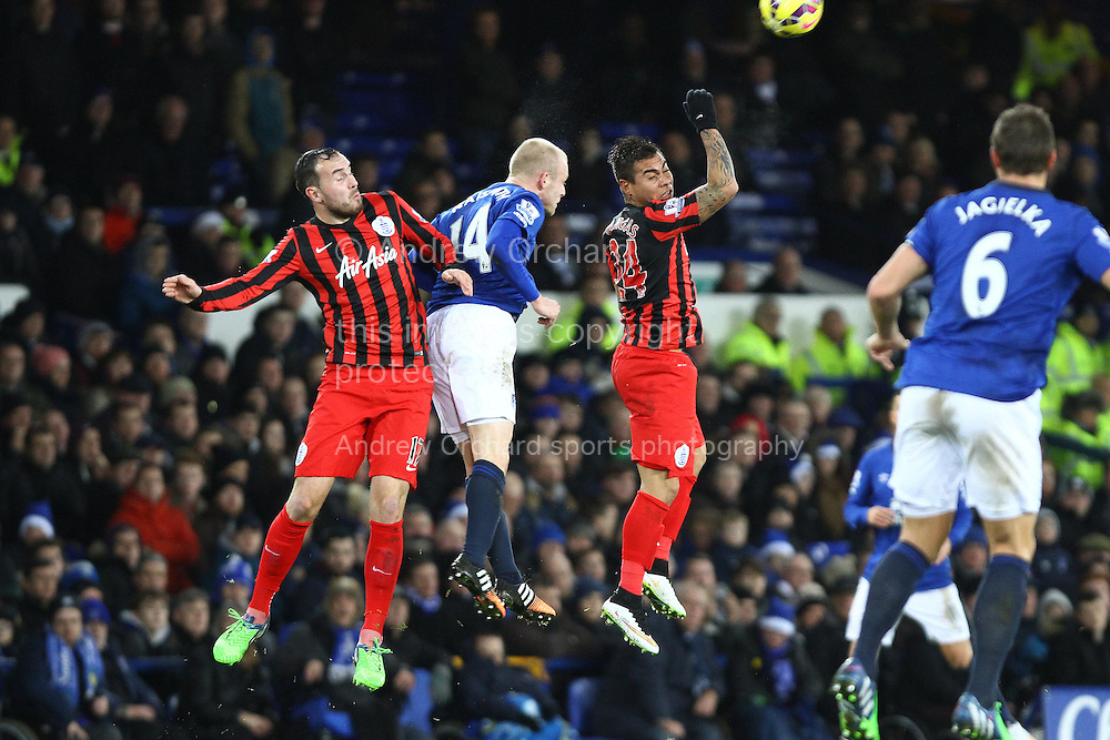 Steven Naismith of Everton is sandwiched between Jordon Mutch and Eduardo Vargas of Queens Park Rangers. Barclays Premier league match, Everton v Queens Park Rangers at Goodison Park in Liverpool, Merseyside on Monday 15th December 2014.<br /> pic by Chris Stading, Andrew Orchard sports photography.