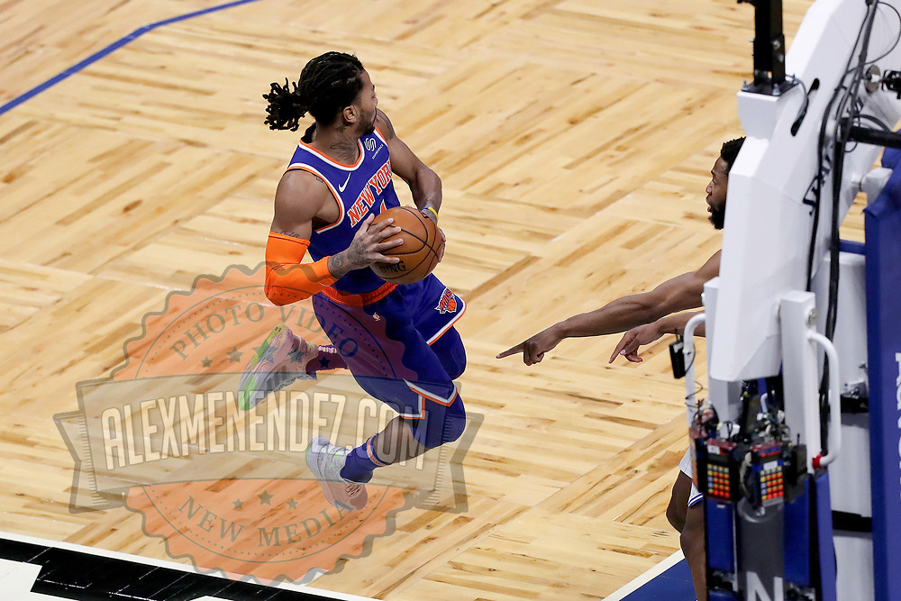ORLANDO, FL - FEBRUARY 17:  Derrick Rose #4 of the New York Knicks makes a leaping save to keep the ball in bounds against the Orlando Magic during the second half at Amway Center on February 17, 2021 in Orlando, Florida. NOTE TO USER: User expressly acknowledges and agrees that, by downloading and or using this photograph, User is consenting to the terms and conditions of the Getty Images License Agreement. (Photo by Alex Menendez/Getty Images)*** Local Caption *** Derrick Rose