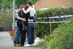 © London News Pictures. 10/06/2012.  Ampthill, UK. A group of friends of Megan-Leigh Peat, embrace each other outside the property where 15-year-old Megan died in the early hours of Saturday morning. Schoolgirl Megan-Leigh Peat was stabbed to death at a house party thrown by a boy whose parents are away on holiday. Photo credit: Ben Cawthra/LNP
