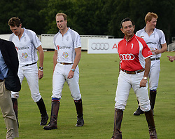 HRH THE DUKE OF CAMBRIDGE followed by HRH PRINCE HARRY OF WALES at the Audi Polo Challenge 2013 at Coworth Park Polo Club, Berkshire on 3rd August 2013.