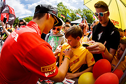 Tim Gajser #243 of Slovenia with fans signing autographs during MXGP Trentino, round 5 for MXGP Championship in Pietramurata, Italy on 16th of April, 2017 in Italy. Photo by Grega Valancic / Sportida