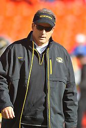 Nov 27, 2010; Kansas City, MO, USA; Missouri Tigers head coach Gary Pinkel watches the team warmup before the game against the Kansas Jayhawks at Arrowhead Stadium. Missouri won 35-7. Mandatory Credit: Denny Medley-US PRESSWIRE