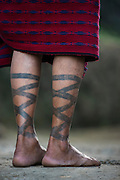 Ao Naga woman with leg tattoos<br /> Ao Naga headhunting Tribe<br /> Mokokchung district<br /> Nagaland,  ne India