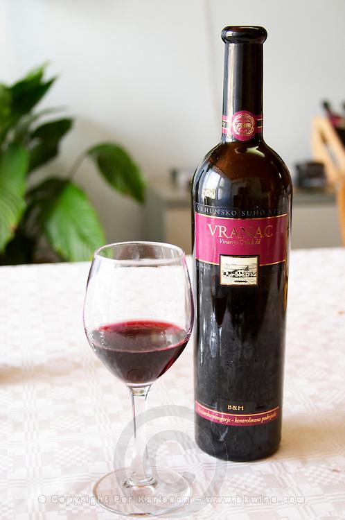 Wine glasses in the tasting room. Bottle of Vranac Vrhunsko Suho Vino red wine. Vinarija Citluk winery in Citluk near Mostar, part of Hercegovina Vino, Mostar. Federation Bosne i Hercegovine. Bosnia Herzegovina, Europe.